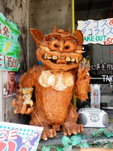 This shisa holding a pair of pigs can be found outside a take-away on Naha's Kokusai Street. Okinawans love pork almost as much as they love shisa, and you'll find plenty of pig-themed souvenirs here.