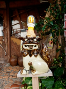 This shisa was one of a pair in the Tsuboya pottery district that had fluorescent lightbulbs gaffa-taped to their heads.
