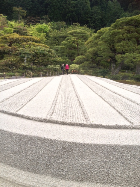 Together alone at last – a couple enjoy the solitude of early morning Ginkakuji Temple. How did they make it across that sand without leaving footprints? A spiritual journey, deep into Zen, indeed!