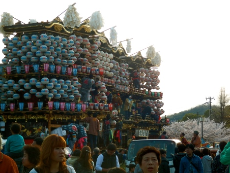 Ready to roll: the festival floats after being hung with their lanterns