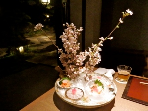 Just one of the amazing dishes served at dinner - sashimi with a sakura garnish