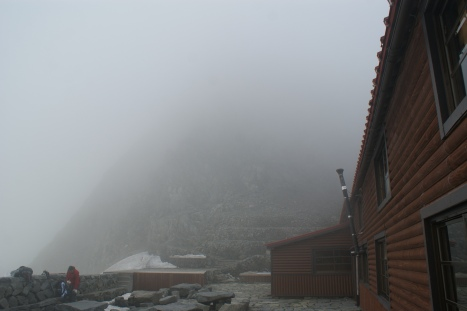 Hotaka Sansou Hut in the gloomy afternoon mist. Food and bedding at 3000m.