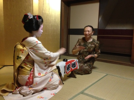 Never guaranteed, but we managed to book afternoon tea at a local teahouse, fortunate enough to enjoy a dance performance, chatting and playing drinking games with a 'maiko' - a trainee geisha.