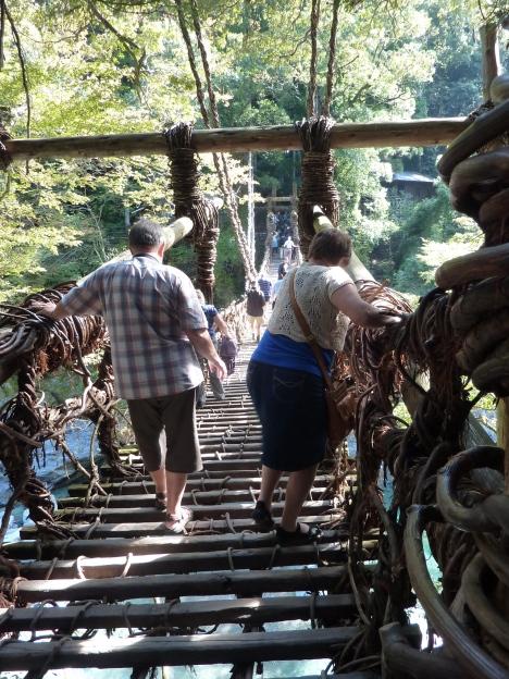 Crossing an Iya Valley vine bridge
