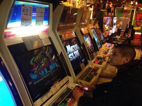 Tour leader William enjoying the arcade games